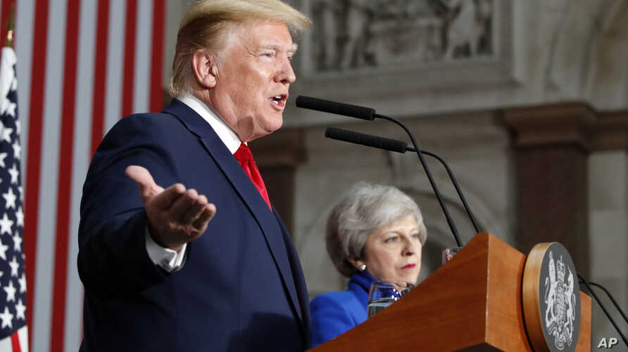 President Donald Trump speaks during a news conference with British Prime Minister Theresa May at the Foreign Office, June 4, 2019, in central London.