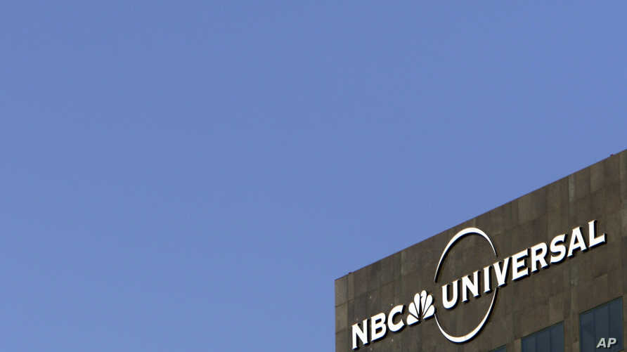 The NBC Universal logo hangs on a building in Los Angeles, Dec. 3, 2009.