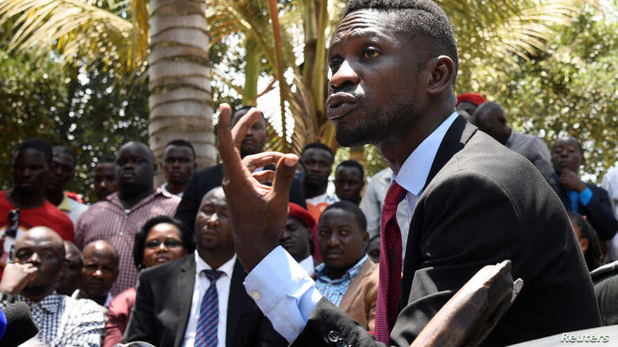 FILE - Ugandan musician-turned-politician Robert Kyagulanyi, also known as Bobi Wine, gives a news conference at his home near Kampala, Sept. 24, 2018.