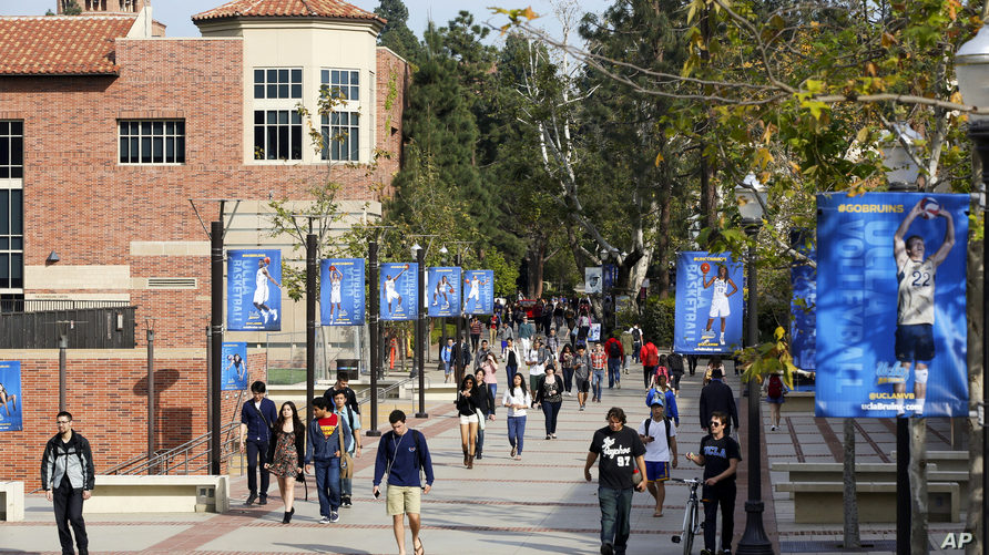 FILE - This Feb. 26, 2015 file photo shows students on the University of California, Los Angeles campus. A quarantine order was issued April 25, 2019, for hundreds of students and staff at two Los Angeles universities who may have been exposed to mea...