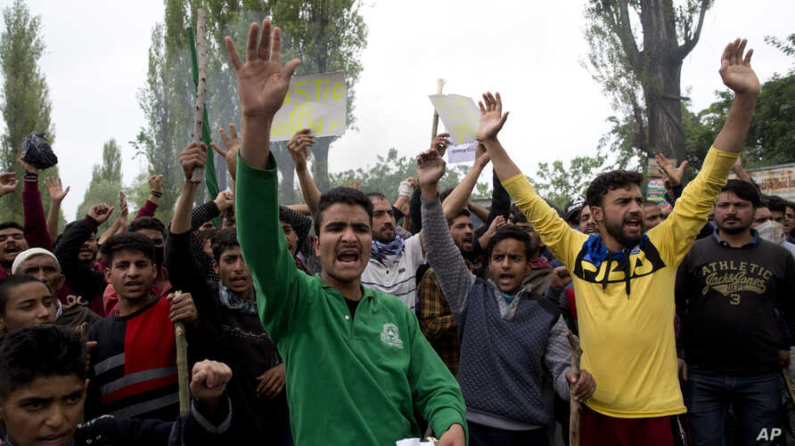 Kashmiri men shout slogans during a protest against the alleged rape of a 3 year old girl from north Kashmir at Mirgund, outskirts of Srinagar, Indian controlled Kashmir, May 13, 2019.