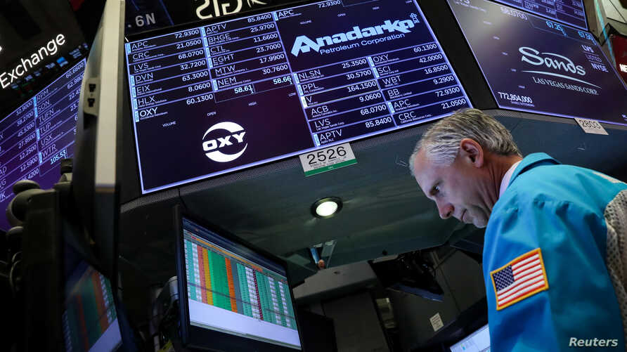 Specialist trader Don Himpele Jr. works at the post that trades Anadarko Petroleum and Occidental Petroleum on the floor at the New York Stock Exchange (NYSE) in New York, U.S., April 30, 2019.