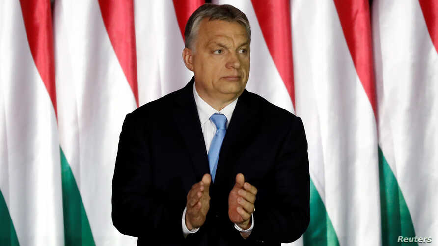 Hungarian Prime Minister Viktor Orban applauds as he presents the program of his Fidesz party for European Parliament elections in Budapest, Hungary, April 5, 2019.