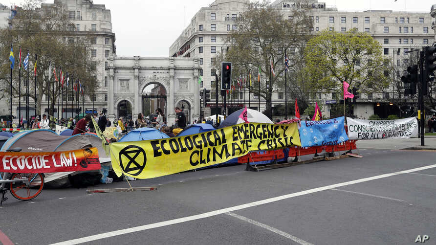 The road is blocked by demonstrators during a climate protest at Marble Arch in London, Tuesday, April 16, 2019.