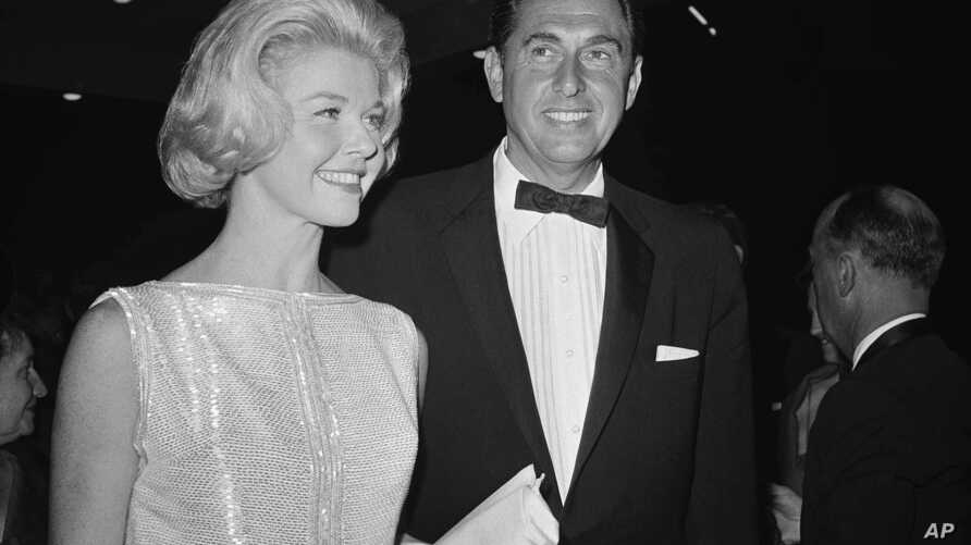 "FILE - Doris Day, a best actress of the year nominee for her role in ""Pillow Talk,"" and her producer husband Marty Melcher, arrive for the annual Academy Award Oscar presentations at the Pantages Theater in Los Angeles, April 4, 1960."