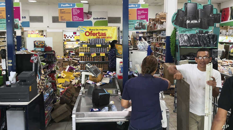 Some supermarket goods lie in the isles after an earthquake in Puerto Armuelles, Panama, May 12, 2019.