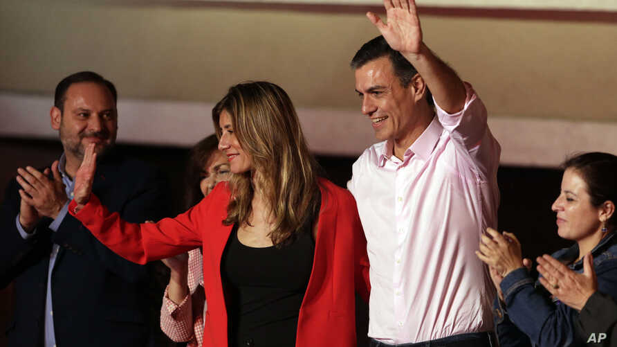 Spanish Prime Minister and Socialist Party candidate Pedro Sanchez stands with his wife Maria Begona Gomez as he waves to supporters gathered at the party headquarters waiting for results of the general election in Madrid, Sunday, April 28, 2019.