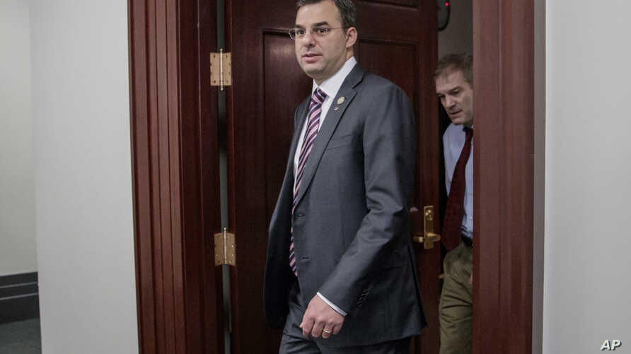 FILE - This March 28, 2017, file photo shows Rep. Justin Amash, R-Mich., followed by Rep. Jim Jordan, R-Ohio, leaving a closed-door strategy session on Capitol Hill in Washington.