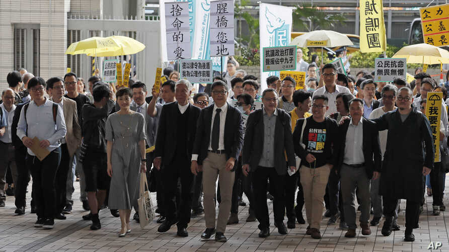 Occupy Central leaders from right; Shiu Ka Chun, Lee Wing Tat, Raphael Wong, Benny Tai, Chan Kin-man, Chu Yiu-ming, Tanya Chan, Eason Chung and Tommy Cheung arrive a court in Hong Kong, April 9, 2019.