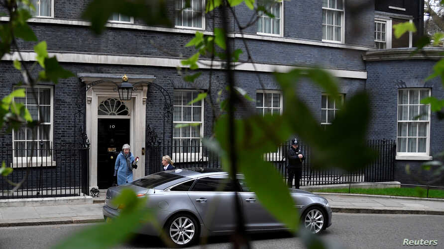 FILE - Britain's Prime Minister Theresa May leaves 10 Downing Street, as she faces a vote on alternative Brexit options, in London, March 27, 2019.