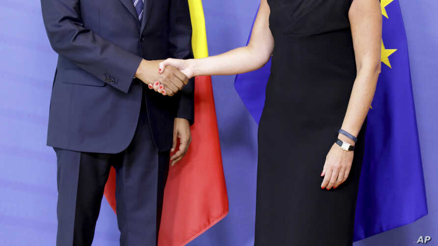 European Union foreign policy chief Federica Mogherini, right, greets Mali's Prime Minister Soumeylou Boubeye Maiga before a meeting at EU headquarters in Brussels, June 28, 2018.
