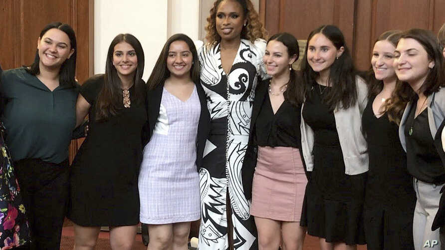 This image taken from video shows singer Jennifer Hudson posing with student journalists from Marjory Stoneman Douglas High School in Parkland, Fla., who were recognized at the 2019 Pulitzer Prize winners awards luncheon at Columbia University in New...