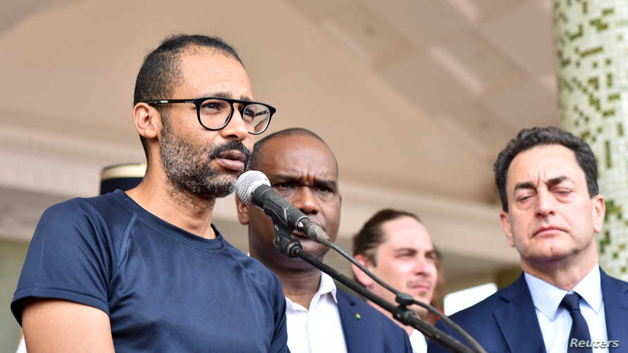 Rescued hostage Laurent Lassimouillas speaks at Burkina Faso's presidential palace in Ouagadougou, May 11, 2019.