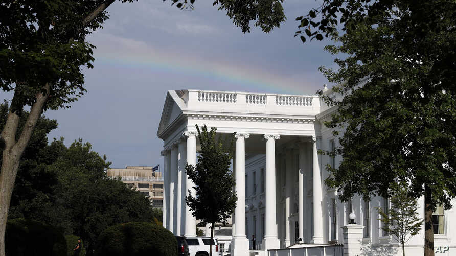 FILE - A rainbow is seen over the North Portico of the White House after a brief rain storm, July 24, 2017, in Washington.