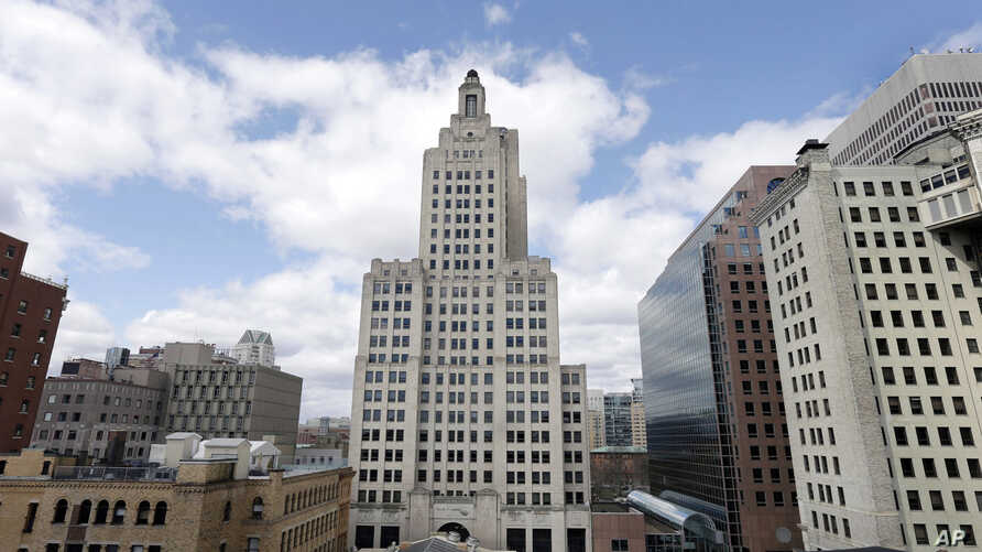 FILE - The Bank of America Building, center, also known as the Superman building, stands among other buildings in downtown Providence, R.I., March 27, 2013.