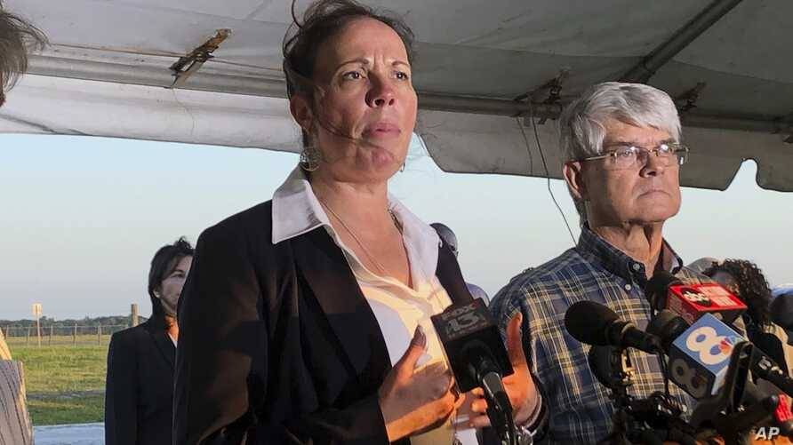Lisa Noland, who survived an attack at the hands of serial killer Bobby Joe Long, speaks to reporters after his execution May 23, 2019, in Starke, Florida.