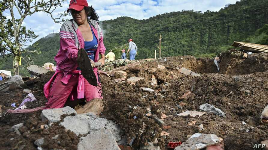 A woman searches for victims after a landslide in Rosas, Cauca department, in southwestern Colombia, April 22, 2019.