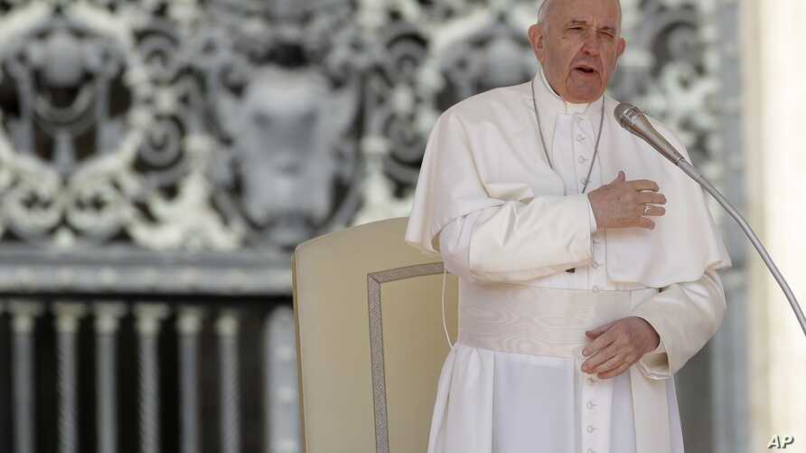 FILE - Pope Francis makes the sign of the cross during his weekly general audience, in St. Peter's Square, at the Vatican, May 8, 2019.