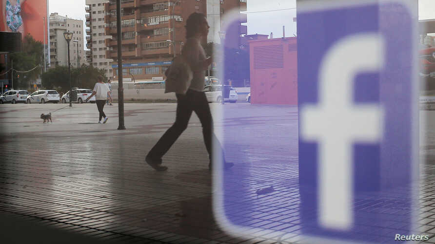 The Facebook logo is seen on a shop window in Malaga, Spain, June 4, 2018.