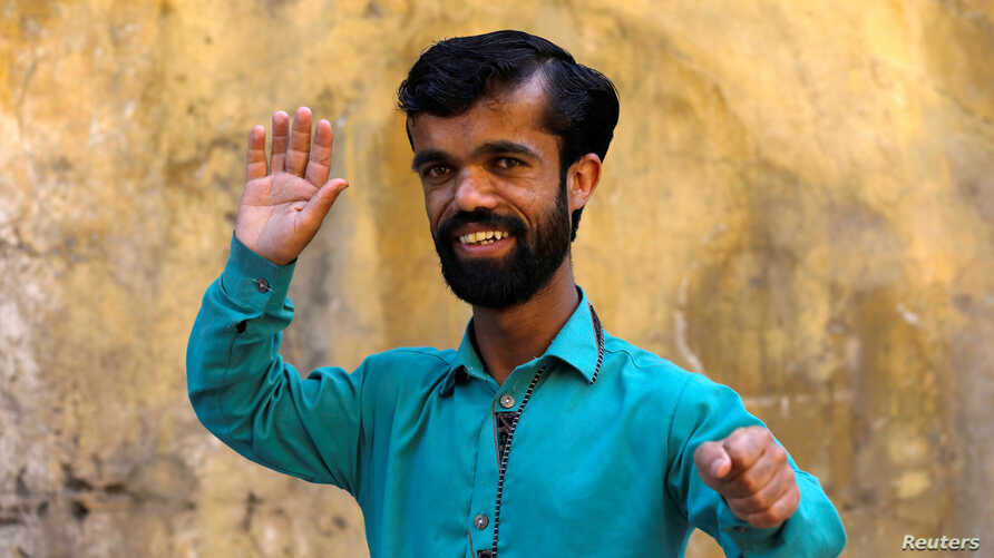 "Rozi Khan, 26, a waiter and a lookalike of Hollywood's actor Peter Dinklage, who plays a character of Tyrion Lannister in the tv series ""Game of Thrones,"" poses for a photograph in Rawalpindi, Pakistan, April 28, 2019."