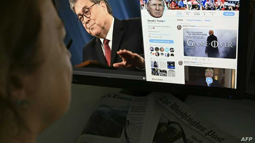 A photo illustration dated April 18, 2019 in Washington, DC shows an editor looking at a photograph of US Attorney General William Barr (L) speaking about the release of the redacted version of the Mueller report, juxtaposed with US President Donald ...