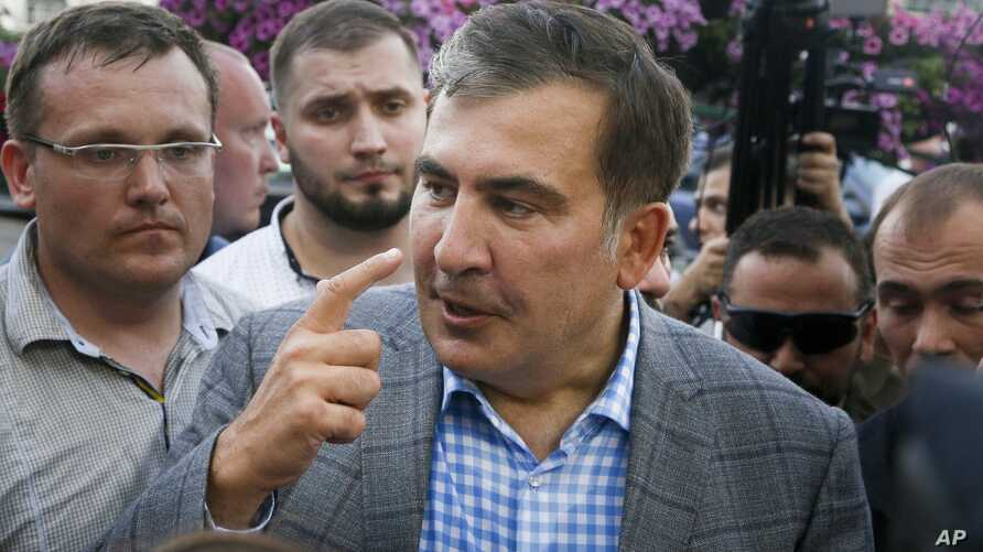 Georgia's ex-President Mikheil Saakashvili gestures as he speaks to reporters upon his arrival at Boryspil Airport, outside Kyiv, Ukraine, May 29, 2019.