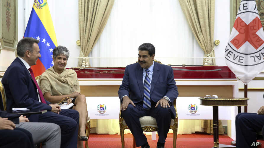 Photo released by Miraflores Press Office shows Venezuela's President Nicolas Maduro (R) meeting with Peter Maurer, president of the International Committee of the Red Cross, at the Miraflores Presidential Palace in Caracas, April 9, 2019.