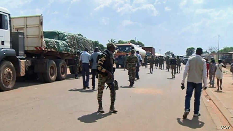 Troops from C.A.R. and Cameroon gather to escort trucks in Garoua Boulai, Cameroon, June 18, 2019. (M. Kindzeka/VOA)