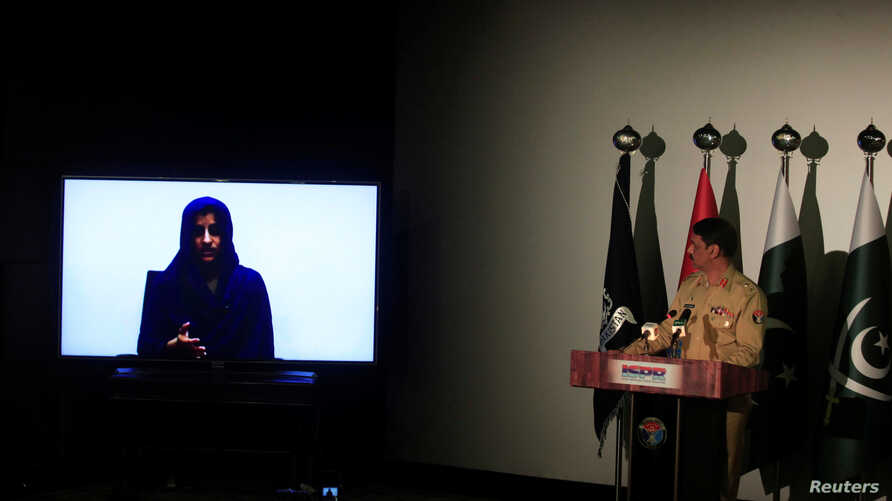 FILE - Noreen Leghari, a would-be Islamic State female suicide bomber, is seen in a video confession shown during a news conference by Maj. Gen. Asif Ghafoor, director general of Inter Services Public Relations in Rawalpindi, Pakistan, April 17, 2017.