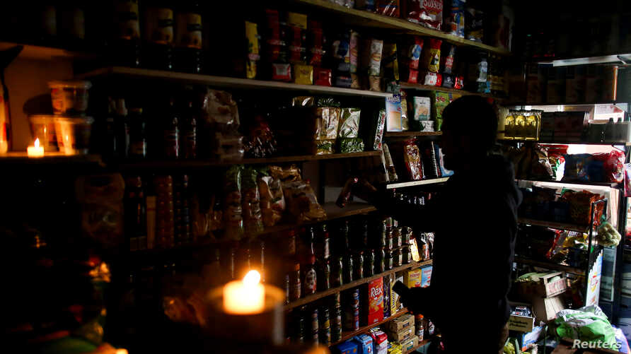 A vendor waits for customers during a national blackout, in Buenos Aires, Argentina, June 16, 2019.