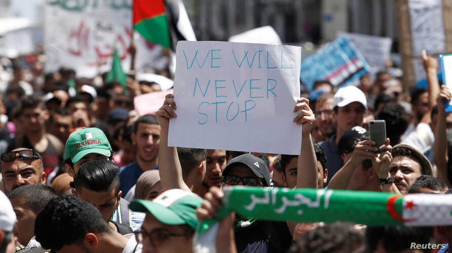 Students carry banners and flags during an anti-government protest in Algiers, Algeria, June 18, 2019.