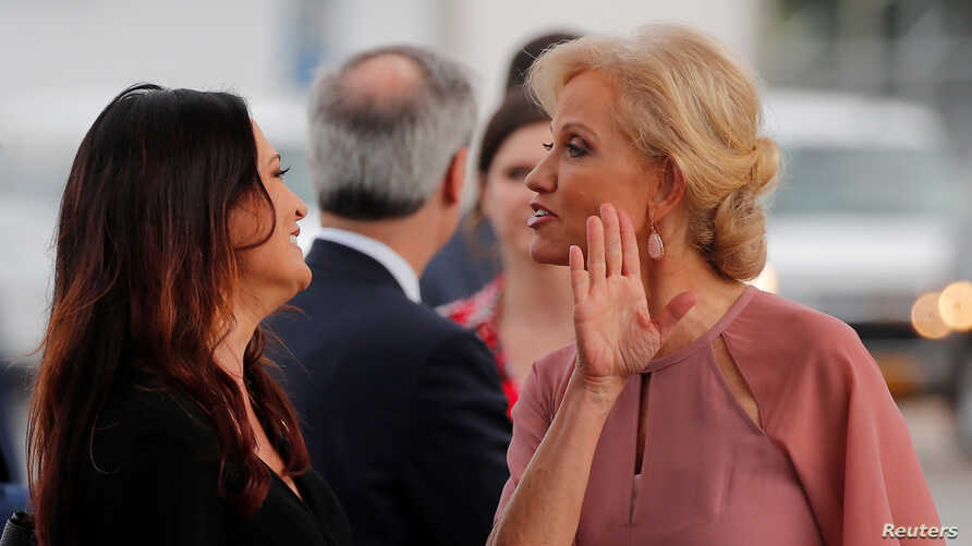 Stephanie Grisham, spokesperson for first lady Melania Trump, reacts with White House senior advisor Kellyanne Conway (R) after arriving for a campaign rally with U.S. President Donald Trump in Orlando, Florida, U.S., June 18, 2019.