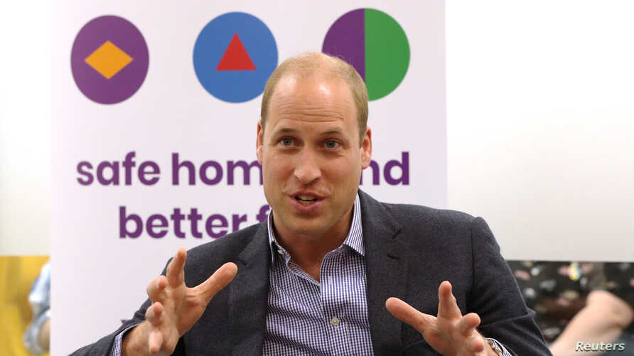 Britain's Prince William, Duke of Cambridge speaks to former and current service users during a visit to the Albert Kennedy Trust in London, Britain, June 26, 2019.
