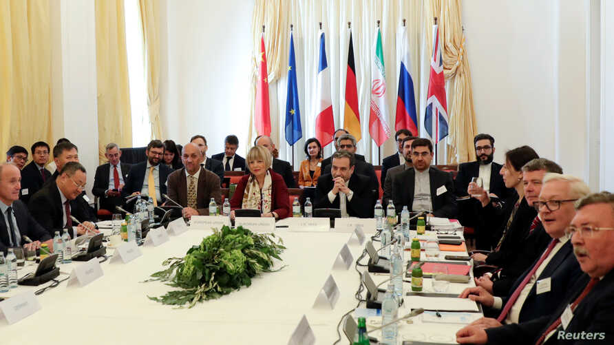 Iran's top nuclear negotiator Abbas Araqchi and Secretary General of the European External Action Service (EEAS) Helga Schmit attend a meeting of the JCPOA Joint Commission in Vienna, Austria, June 28, 2019.