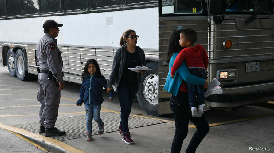 Migrant families seeking asylum are released from federal detention at a bus depot in McAllen, Texas, U.S., June 28, 2019.