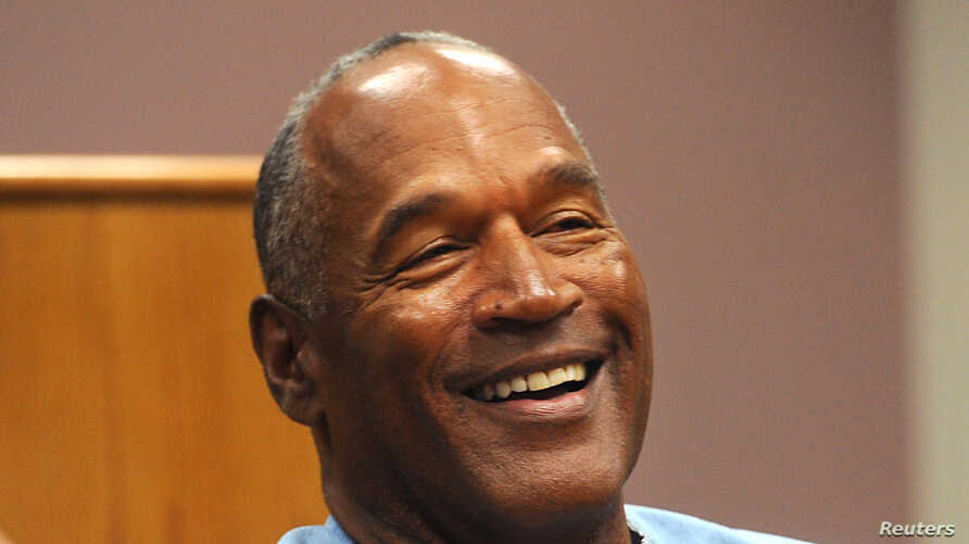 FILE - O.J. Simpson reacts during his parole hearing at Lovelock Correctional Center in Lovelock, Nevada, July 20, 2017.