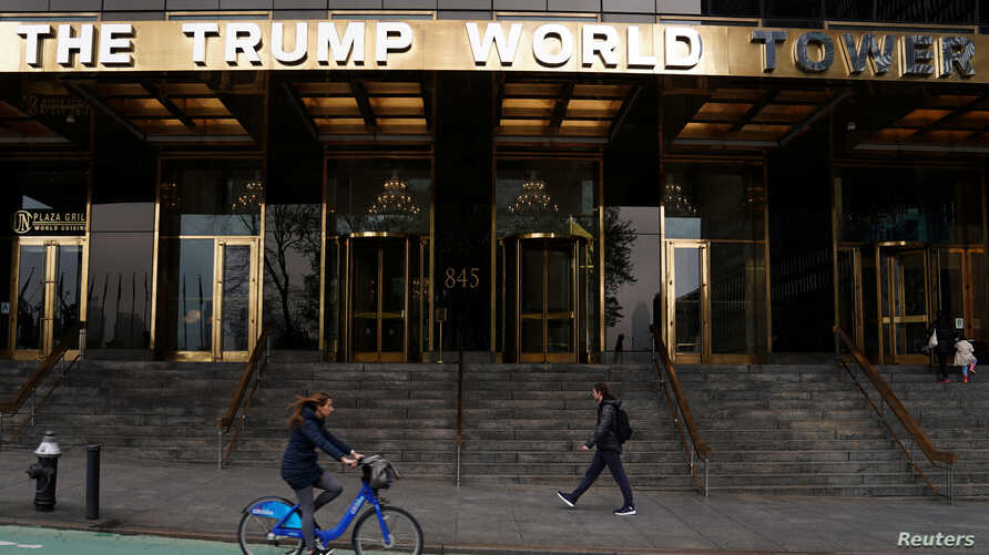 FILE - People pass by the Trump World Tower in the Manhattan borough of New York, New York.