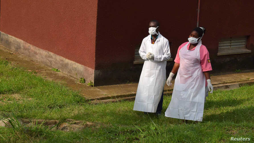 Ugandan medical staff inspect the Ebola preparedness facilities at the Bwera general hospital near the border with the Democratic Republic of Congo in Bwera, Uganda, June 12, 2019.