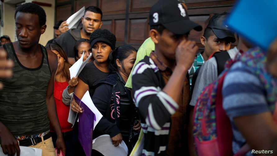 Cuban migrants wait outside the Mexican Commission for Refugee Assistance (COMAR) in Tapachula, Mexico, June 14, 2019.
