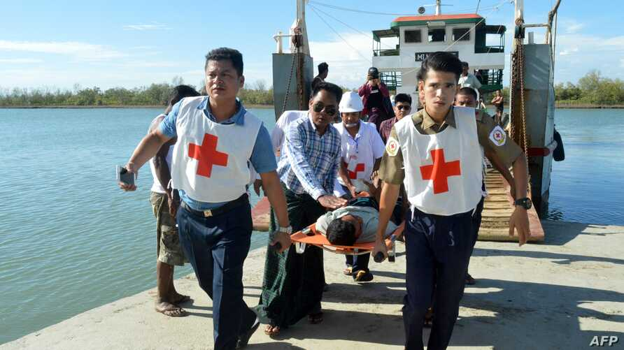 Injured people from Kyauk Tan village in Rathedaung township are carried on stretchers as they arrive in Rakhine state's capital Sittwe in western Myanmar, May 2, 2019.