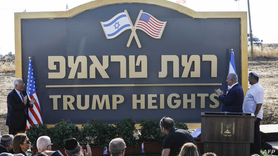 "Israeli Prime Minister Benjamin Netanyahu (2nd-R) and U.S. Ambassador to Israel David Friedman (L) applaud after unveiling the place-name sign for the new settlement of ""Trump Heights"" during a ceremony in the Israeli-annexed Golan Heights, June 16, 2019."
