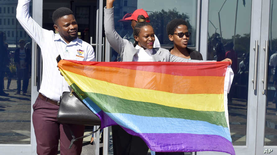 Activists celebrate the High Court's ruling to decriminalize gay sex outside the High Court in Gaborone.
