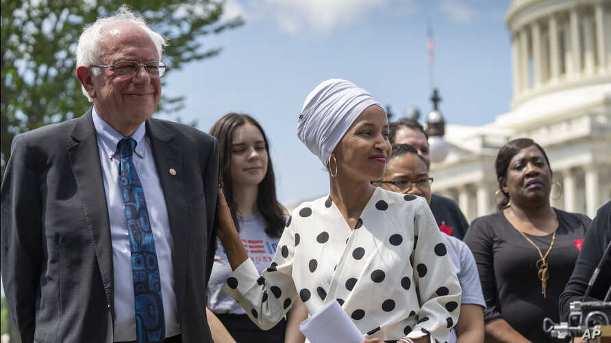 Democratic presidential candidate Sen. Bernie Sanders, I-Vt.., left, and Rep. Ilhan Omar, D-Minn., the sponsors of legislation to cancel all student loan debt, hold a news conference at the Capitol in Washington, June 24, 2019.
