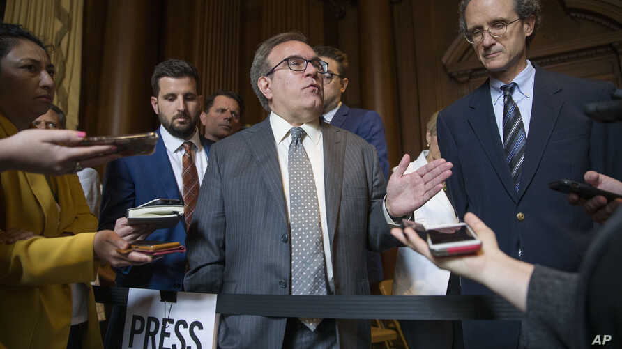 EPA administrator Andrew Wheeler speaks with the media at the Environmental Protection Agency, June 19, 2019, in Washington.