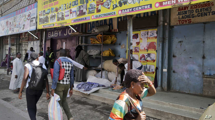 Kenyans walk past closed shops in the capital after an attack on a hotel complex, claimed by al-Shabab, in Nairobi, Kenya, Jan. 18, 2019.