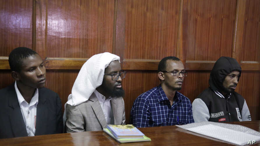 From left to right: defendants Rashid Charles Mberesero, Sahal Diriye Hussein, Hassan Aden Hassan and Mohamed Abdi Abikar, sit in the dock to hear their verdict at a court in Nairobi, Kenya, June 19, 2019.