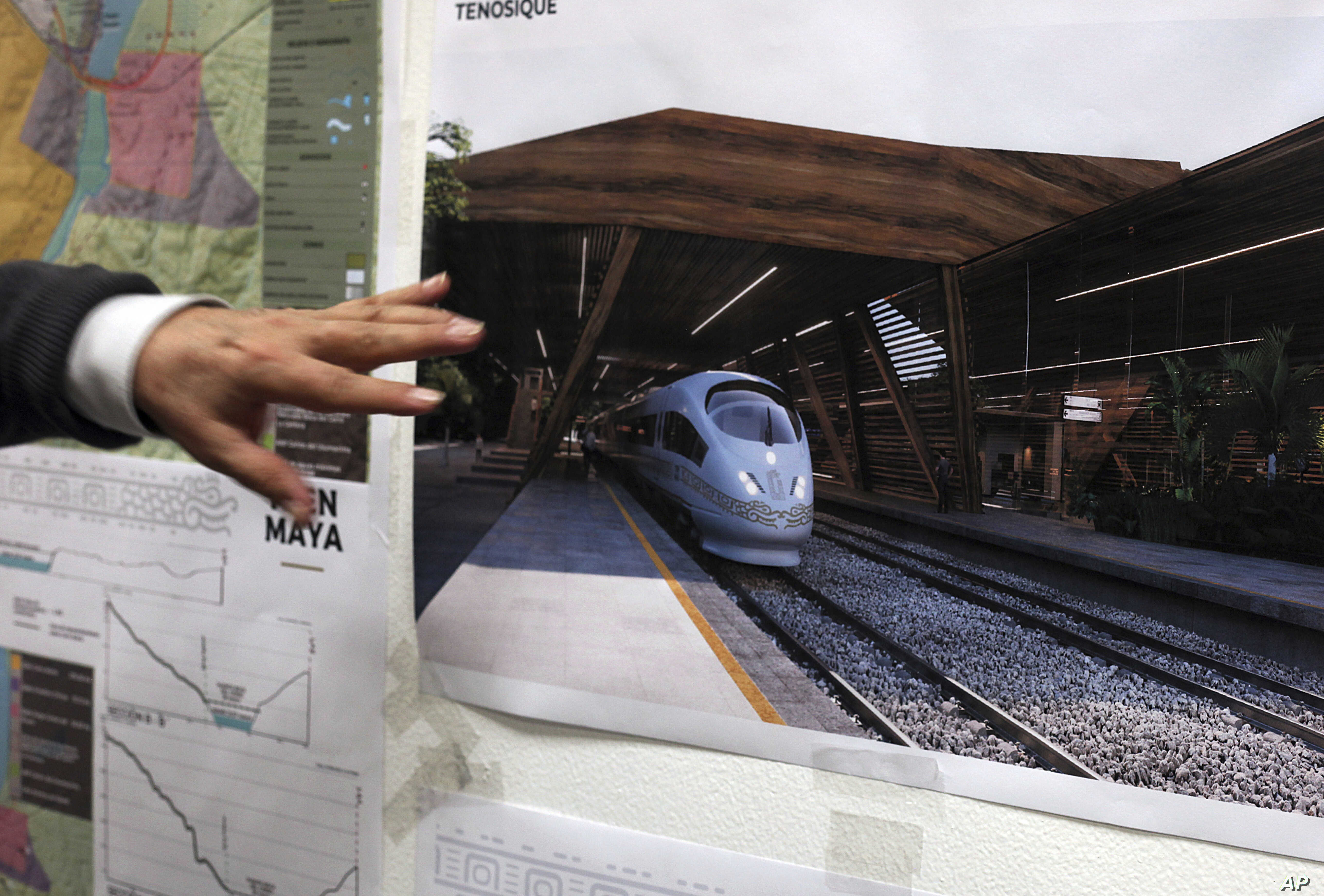 Rogelio Jiménez Pons, director of Fonatur, points to photos of a planned train through the Yucatan Peninsula, during an interview in Mexico City, Monday, March 18, 2019.