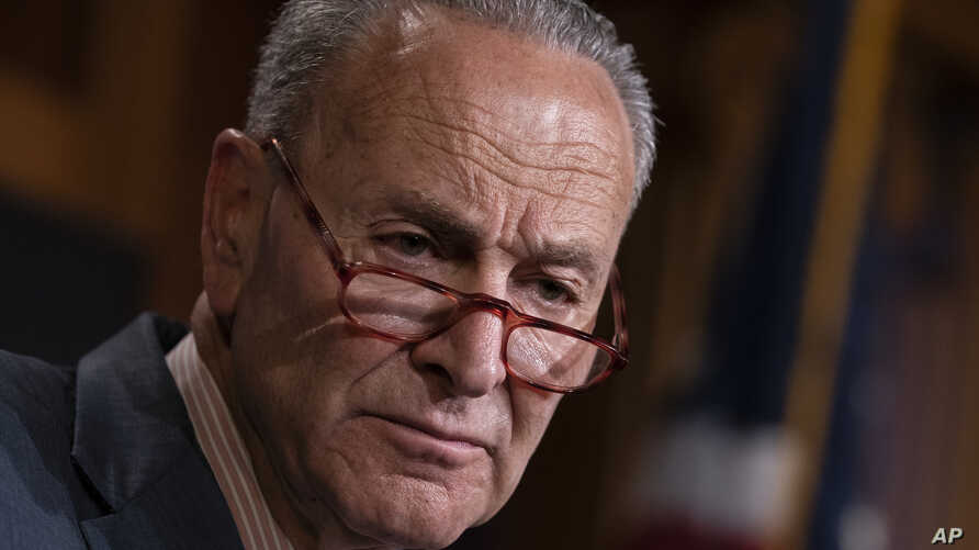 Senate Minority Leader Chuck Schumer, D-N.Y., talks to reporters at the Capitol in Washington, June 18, 2019.