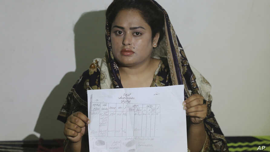 Pakistani Christian Natasha Masih girl shows her marriage certificate during an interview in Faisalabad, May 14, 2019.