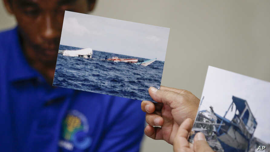 Photos of the damaged Filipino fishing vessel F/B Gimver 1 is shown next to one of its crew Richard Blaza during a press conference in metropolitan Manila, Philippines, June 17, 2019.
